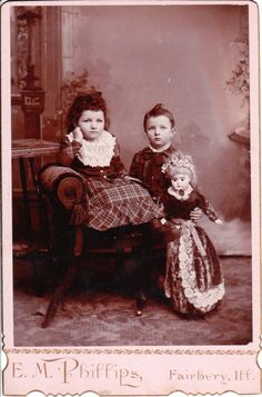 TWO SMALL CHILDREN AND ONE LARGE DOLL IN FAIRBURY, ILLINOIS