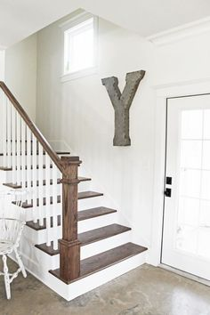 Simple oak and white staircase from Brittany York's Sugarberry Cottage Farmhouse Louisiana