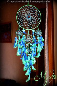 Seashell and Feather Decorated Dream catcher.