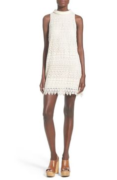 """ASTR 'Sharona' dress A bohemian-inspired overlay of openwork crochet sweetens the streamlined silhouette of a leg-flaunting dress finished with a band collar and a back keyhole cutout. 34"""" length (size Medium). Back keyhole with hook-and-bar closure. Band collar. Sleeveless. Lined. 100% polyester. Dry clean. Savvy"""