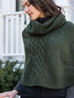 This cozy poncho is worked in garter stitch in the round from the top down. An oversized cowl neck tops cable panels on the front and back. Cable pattern is charted.