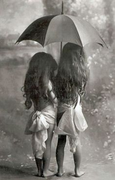 Best friends playing in the rain