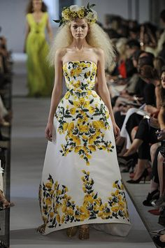 Ignore the hair. Look at the embroidered dress, which I can't help think is reminiscent of a tablecloth. I'd never wear it, but someone could, roughed up with a leather jacket. (Oscar de la Renta)