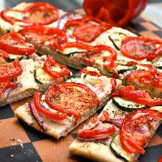 Roasted vegetable flat breads with goat cheese. Keeping this for when our fresh zucchini and tomatoes are ready in the garden and let's grill it!