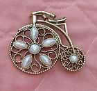 Vintage 1928 Jewelry Co Gold Tone Filigree Faux Pearl Vintage Bicycle Pin Brooch - 1928, Bicycle, Brooch, Faux, Filigree, Gold, Jewelry, Pearl, tone, Vintage http://designerjewelrygalleria.com/1928-jewelry/1928-pins/vintage-1928-jewelry-co-gold-tone-filigree-faux-pearl-vintage-bicycle-pin-brooch/