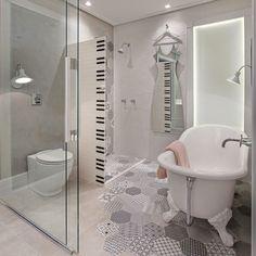A arquiteta Isabelle Lattaro segue a tendência de aplicar revestimentos de forma assimétrica, como no mosaico de revestimento hexagonal trabalhado no piso.