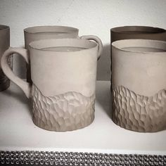 Carved, textured cups