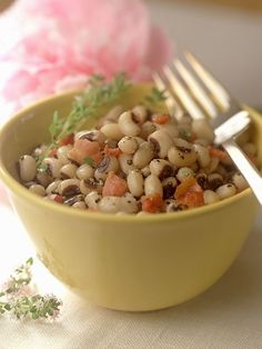 Black-Eyed Peas- On New Year's Day eat at least one black eyed pea for each day of the New Year to bring coins since they resemble coins.