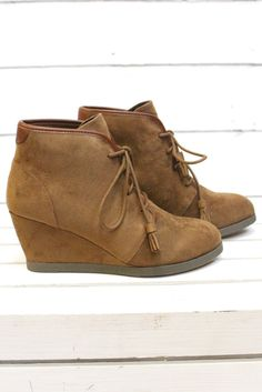 Lace up in these amazingly soft wedge booties to complete your casual look! Chic and versatile, these trendy ankle boots will become a fast favorite in your fall wardrobe! - Faux suede upper - Lace-up