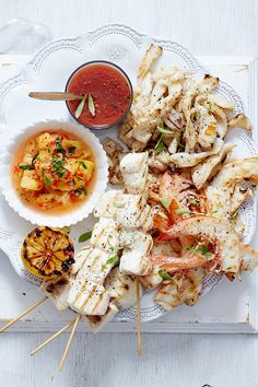 Barbecue Seafood Platter A Feast From The Sea Is Just What Your Christmas Spread Needs This Delicious Platter Packed With Prawns Fish Skewers And Squid Makes A Beautiful Addition To Any Family Meal These Holidays Christmas Roast, Christmas Lunch, Christmas Ideas, Grilled Shrimp Kabobs, Prawn Fish, Seafood Platter, Food Carving, Roast Dinner, Xmas Food