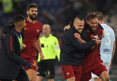 Alberto De Rossi, Radja Nainggolan and their teammates of AS Roma celebrate the victory after the Serie A match between AS Roma and SS Lazio at Stadio Olimpico on November 18, 2017 in Rome, Italy. - 163 of 243