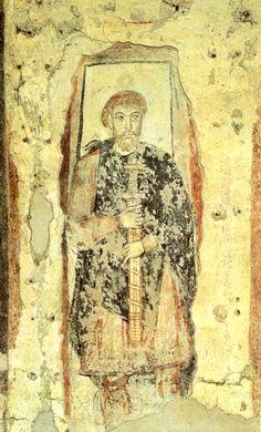 Aristocrate carolingien (Fresques du IX°s, église San Benedetto, Malles, Italie)- CHARLEMAGNE 4)BIOGRAPHIE. 4.4 CONDITIONS DE L'EXPENSION 4.4.2 ORGANISATION POLITIQUE DU ROYAUME, 1: Dans le royaume franc, les puissants (principalement les ducs, comtes et marquis) accueillent des hommes libres qu'ils éduquent, protègent et nourrissent. L'entrée dans ces groupes se fait par la cérémonie de la recommandation: ces hommes deviennent des guerriers domestiques (vassi) attachés à la personne du seni...