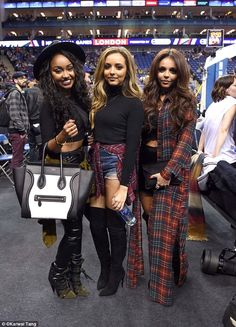 On trend: Her bandmate Jade was a similar wave length as she wrapped a tartan shirt around her waist