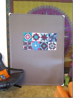 Easy design wall: Kay Sorensen made this with a gray flannel sheet, 4 pieces of PVC pipe and 4 PVC pipe elbows.