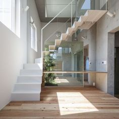 House-K: Architects: K2YT Location: Tokyo, Japan Area: 291.0 sqm  Urban framing on the facade invites natural light and air to enter the interior spaces.
