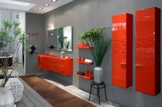 des colonnes de salle de bains et un meuble vasque orange