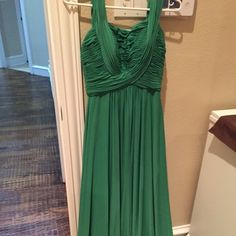 Long elegant emerald dress. Beautiful emerald gown. Worn once at a wedding. Great design in the bust area. (Minor safety pins on bust area not noticeable) Dry cleaned and tag is falling off. Bought from Macy's. Size 6. Lowered the price. JS boutique Dresses Maxi