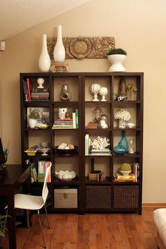 Stylized ikea bookshelves - add baskets for toy storage in the den