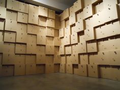 "Zimoun, ""294 prepared dc-motors, cork balls, cardboard boxes 41x41x41cm"" (2012), motors, power supply, steel, cork, cardboard (all photos by Ben Valentine for Hyperallergic)"
