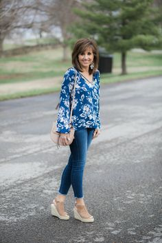 Cute Criss-Cross Blouse and beautiful color.  Not sure if the print would be a little much for me.