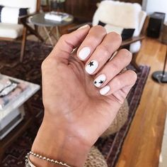 No color, no problem. You don't need to go bright to make mismatched nails s… No color, no problem. You don't need to go bright to make mismatched nails stand out. devon palumbo's stars are achieved with just two shades: OPI's Alpine Snow and Black Onyx. White Nail Art, White Nails, Red Nail, Black Nail, How To Do Nails, Fun Nails, Bling Nails, Nagellack Trends, Star Nails