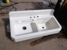This one has the mounting holes integrated in the sink. Vintage 1939 American Standard Cast Iron 2 Bay Sink