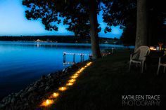 Wedding.  Votives in baby food jars. Very little cost.  Very big impact.  Kathleen Trace Photography. www.kathleentrace.com.
