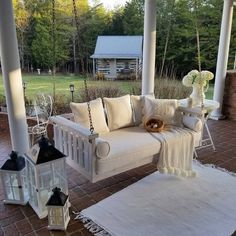You have to see this shabby chic outdoor space decor idea with a cozy porch swing. Love it! #HomeDecorIdeas @istandarddesign