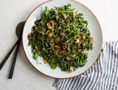 Recipe for: Kale and Arugula salad with crispy brussel sprouts. We're more than a little bit obsessed with this Caesar-inspired salad, which gets its crunch from crispy Brussels sprouts instead of croutons.