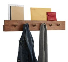 If you're lacking hanging storage space, consider installing a hardy coat rack like this acacia piece from CB2.