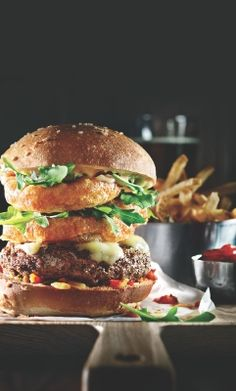Bronx Burger with beer-battered onion rings, at Earls. #Whistler BC (Photo courtesy of Earls)