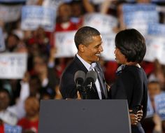 Michelle Obama Barack Obama Photos Photos - U.S. President Barack Obama hugs his wife Michelle at a rally at Ohio State University on October 17, 2010 in Columbus, Ohio.  The rally of approximately 35,000 comprised the largest crowd that Obama has addressed since his inauguration. - President Obama And First Lady Attend DNC Rally In Columbus
