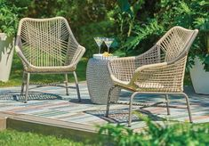 Freshen up your outdoor living space with a stylish and on-trend mid-century modern accent chair. With metal and resin roping, the patio chair is comfortable yet sturdy and weather resistant. Add a seat cushion or throw pillow for added comfort.