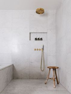 Marble tiled bathroom with gold fixtures