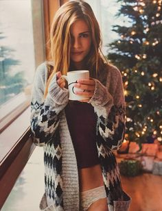 Love me a woman with a cardigan and a cup of coffee