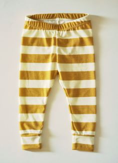 ac99806f1 Adorable baby or toddler girl leggings in a mustard yellow and ivory  striped print, made