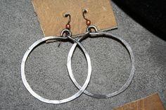 Steel hoop earrings by artist Emily Ehr
