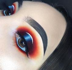 Orange Blue White Black Eyeshadows   Bold Colorful Eye Look   Spotlight Halo Eye Makeup   Instagram Perfect Arch Dark Eyebrows   Makeup for Brown Eyes   White Liner #makeup #orange #eyebrows #blue #halo #eyemakeup #eyeshadow #makeupartist  Pin: @amerishabeauty