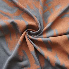 A blend of two natural fibres, beech wood (85%) and silk (15%), this is a single jersey that has been rotary printed in the UK. This means that the print is slightly raised and sits on top of the fabric's surface. The grey fibre also has a slight sheen to it, so alongside the raised peach print, the fabric has an amazing depth and texture. It is a beautiful and delicate fabric, slightly see-through, ideal for more feminine styles, sleepwear, lingerie and sportswear. There is a little stre...