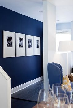 the navy blue wall/white trim, so pretty with black and whites in white frames, pop of yellow accessories