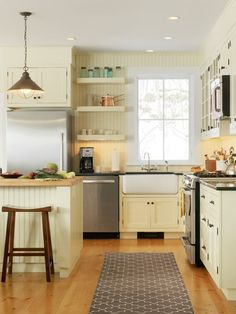 Farmhouse Kitchen by Cushman Design Group. Beadboard adds a traditional country element to any kitchen.