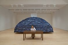 'Indigo blue with Hamilton's attempt to unearth this history. The work is comprised of approximately 18,000 pieces of used, blue, cotton work clothes. The uniforms of anonymous blue-collar workers, whose names for the most part are lost from written histories.' http://www.marthagarzon.com/contemporary_art/2011/01/ann-hamilton-indigo-blue/ For an interview with Ann Hamilton about this work see Artists Speak Board.