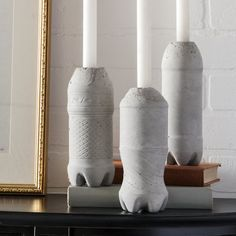 Use plastic bottles to make these unique concrete candle holders.