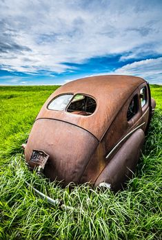 Abandoned Car. Praire Spaceship, Landed in a field in rural Alberta. It's called ...Mercury! Photo by A O'Brien. Source Flickr.com