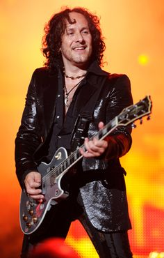 Vivian Campbell of Def Leppard performs in Wantagh, New York.