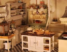 Here is the kitchen of a mouse mansion on a webpage from miniatures-artist Christel Jensen of Norway.  It's an apple tree where mice will be producing apple cider and apple pies in the kitchen.  Jensen makes food, flowers and other small items in 1/12 scale, in polymer clay.  Her website is http://www.littletreasure.no/  ☺ Pinned by Nancy Lee Moran in 2015