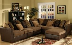 7 pc 2 tone fabric and leather like vinyl upholstered modular sectional sofa set with throw pillow back
