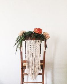These macramé chair-backs add a romantic and beautiful boho look to your reception, ceremony, bride and groom chairs, or any special occasion. Made from soft cotton rope. Hung on adjustable rope with tassels. Long fringe hangs at the bottom. Add your own flowers or greenery or use alone. Can be hung on your wall or used at your dining room table later. Dimensions: Approximately 2ft long and 1 foot wide. These are custom made. I can make them shorter or longer. Just message me with detai...