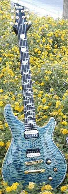 Custom Made Guitar - love the phases of the moon inlays!