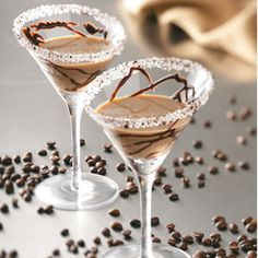 Coffee & Cream Martini (2 Tbs coarse sugar 1 tsp finely ground coffee 1.5 oz vodka 1,5 oz Kahlua 1,5 oz Irish cream liqueur Chocolate syrup)